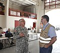 U.S. Army Maj. Gen. Myles Deering, left, the adjutant general of Oklahoma, speaks with a member of the Oklahoma Department of Emergency Management May 25, 2013, at the incident command center at the fire 130525-Z-VF620-3972.jpg