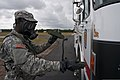 U.S. Army Spc. Jerame Smalls, assigned to the 108th Chemical Company, S.C. Army National Guard, uses radiation detection equipment to find harmful gamma and beta radiation on contaminated vehicles during 130519-Z-XH297-023.jpg