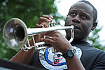 U.S. Army Staff Sgt. Jukabiea Barlow, with the 9th Army Band, 2nd Engineer Brigade, plays the trumpet as he performs during the brigade's special event, called Arctic Trailblazer Week, at Cottonwood Park on 120810-F-LX370-810.jpg