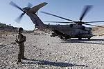 U.S. Marine Corps Cpl. Ryan P. Wells, a crew chief with Marine Heavy Helicopter Squadron (HMH) 462, waits next to a CH-53E Super Stallion helicopter in Kajaki, Helmand province, Afghanistan, Oct. 7, 2013 131007-M-SA716-080.jpg