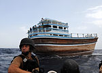 U.S. Navy Lt. j.g. Andrew Mechling, the lead boarding officer with a visit, board, search and seizure (VBSS) team, speaks with other VBSS team members during an approach operation on a dhow near guided-missile 090830-N-ZL677-016.jpg