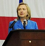 U.S. Secretary of State Hillary Rodham Clinton, top center, delivers a speech to more than 1,000 Sailors, Soldiers, Airmen and Marines at Anderson Air Force Base, Guam 101029-F-OE121-209 (cropped).jpg