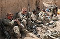 U.S. Soldiers with the 3rd Platoon, Charger Company, 1st Battalion, 5th Infantry Regiment break for lunch at Checkpoint Molla Dust April 1, 2012, in Panjwai district, Kandahar province, Afghanistan 120401-N-BS894-138.jpg