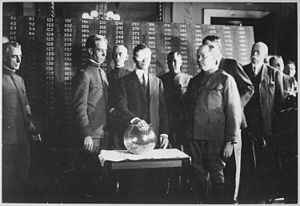 Green Corn Rebellion - Secretary of War Newton Baker draws the first number of the lottery created by the 1917 Selective Draft Act.