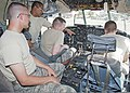 U.S Air Force Staff SSgt Patrick Uribes, second from left, an aircraft maintenance instructor, describes the various gauges in a C-130 Hercules aircraft cockpit to Airmen 1st Class Joshua Stout, left, Thaddeus 110616-F-NS900-010.jpg