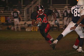 A running back turns up the field in an attempt to reach the end zone. USMC Running back.jpg