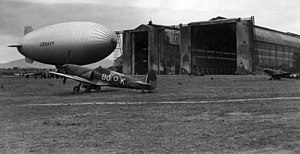 USN blimp with RAAF Spitfires at Cuers-Pierrefeu 1944.jpg
