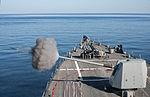 USS Winston S. Churchill fires its 5-inch gun..jpg