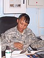 US Army 52312 Spc. Anika Alcala, a supply specialist with the 395th Combat Sustainment Support Battalion, reads at her desk in the supply office. Alcala, from Brooklyn, N.Y., is pursuing a degree in criminal justi.jpg