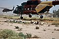 US Army 53452 CAMP TAJI, Iraq-Soldiers from the 34th Iraqi Army Brigade, 9th IA Division, stay low and take defensive positions after being air inserted into a simulated battlefield by an MI-17 Hip helicopter (righ.jpg