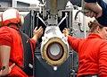US Navy 020805-N-9593M-009 Sailors load RIM-7 missiles into launcher aboard CVN 72.jpg