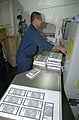 US Navy 021230-N-4655M-001 preparing leaflets that will be dropped over Iraq.jpg