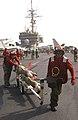 US Navy 030320-N-1810F-007 Aviation ordnancemen relocate 2,000-lb. GBU-31 Joint Defense Attack Munitions (JDAMs) for uploading to aircraft aboard USS Kitty Hawk (CV 63).jpg
