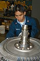 US Navy 030519-N-2911P-006 Aviation Machinist's Mate 2nd Class Manolito Pimentel from Manila, Republic of the Philippines, installs veins on the rotor of a T-56 engine.jpg