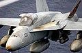 US Navy 031026-N-9411J-009 An F-A-18A Hornet flies over the Western Pacific Ocean during flight operations.jpg