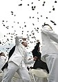 US Navy 040528-N-9693M-023 Newly commissioned officers celebrate their new positions by throwing their Midshipmen covers into the air as part of the U.S. Naval Academy class of 2004 graduation and commissioning ceremony.jpg
