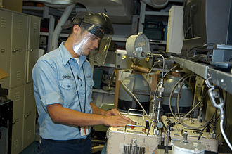 Calibration - Automatic calibration - A U.S. serviceman using a 3666C auto pressure calibrator