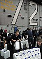 US Navy 050104-N-4166B-128 Sailor's assigned to the Reactor Department and Repair Division aboard USS Abraham Lincoln (CVN 72) fill jugs with purified water from a Potable Water Manifold.jpg