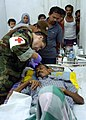 US Navy 050116-N-6817C-285 U.S. Navy Lt. Cmdr. Ramon Cestero, of San Diego, Calif., treats an infected head wound on an Indonesian man while on survey mission on the island of Sumatra, Indonesia.jpg