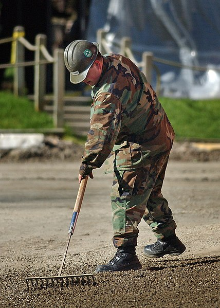File:US Navy 050322-N-4385W-009 Equipment Operator 3rd Class Steven Veldhuizen, assigned to Construction Battalion Unit 417, prepares landscape for asphalt on board Naval Air Station Whidbey Island, Wash.jpg