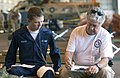 US Navy 050526-F-5586B-110 Pharmacist, Florida One Disaster Medical Assistance Team member, James Tate, takes personal information from Air Traffic Control Student, Airman Apprentice James Inman during exercise Lifesaver 2005.jpg