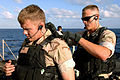 US Navy 060128-N-4374S-003 Members of Visit, Board, Search and Seizure (VBSS) team, assigned to the dock landing ship USS Carter Hall (LSD 50), perform gear checks.jpg