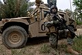 US Navy 060328-N-6901L-118 U.S. Army Spc. Osvaldo Fernandez stands perimeter security in front of an M1114 HMMWV (Humvee) near the town of Tarmiya, Iraq during counter-insurgency operations.jpg