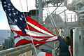 US Navy 060331-N-7293M-450 Quartermaster 2nd Class Tamika Shead raises a giant battle flag aboard the Ticonderoga-class guided missile cruiser USS Cowpens (CG 63) during a joint U.S.-Russian naval exercise.jpg