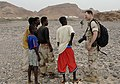 US Navy 060703-N-9500T-008 Mass Communication Specialist 2nd Class Roger Duncan, assigned to Combat Camera, Combined Joint Task Force-Horn of Africa, talks with local villagers during a well-assessment mission.jpg