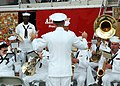 US Navy 061022-N-7427G-001 Master Chief Musician Willie Harris conducts the New Orleans Navy Band as they play the National Anthem for the N'awlins Air Show aboard Naval Air Station Joint Reserve Base, New Orleans.jpg
