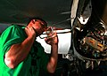 US Navy 061108-N-6364G-117 Aviation Structural Mechanic 3rd Class Wyatt Arnall tightens a screw on a panel of an F-A-18F Super Hornet.jpg