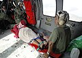 US Navy 070907-N-7540C-007 An aircrewman checks on an injured passenger just before take-off during a medical evacuation.jpg