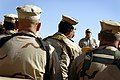 US Navy 071122-N-5549O-267 Secretary of the Navy (SECNAV) the Honorable Donald C. Winter speaks with Sailors and Marines at Haditha Dam during a Thanksgiving Day visit to the Central Command area.jpg