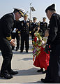 US Navy 080220-N-8534H-002 U.S. Navy Capt. Andy Hale, commanding officer of the guided-missile submarine USS Ohio (SSGN-726), receives a traditional Republic of Korea (ROK) welcome from a young Korean girl.jpg