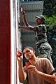 US Navy 080720-N-9689V-001 Steelworker 3rd Class Jonah Soto and Indian Army Cpl. Kallaseril Vinu paint window frames.jpg