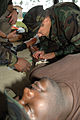US Navy 080801-N-4740L-001 Corpsman from Construction Batallion Center Gulfport train during the Tactical Combat Casualty Care Course.jpg