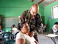 US Navy 090331-N-1580K-322 Nurse practitioner Lt. Cmdr. Matt Ridder checks the breathing of a villager during the Beyond the Horizon humanitarian exercise in Honduras.jpg