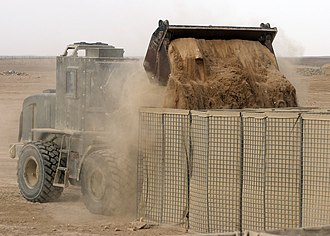 Operation Herrick - A front end loader filling HESCO barriers during a project at Camp Bastion