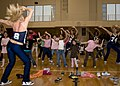 US Navy 090414-N-2638R-003 Dallas Cowboy Cheerleaders lead a group of girls from the Fleet Activities Yokosuka community during a cheerleading clinic at Purdy Gym at Fleet Activities Yokosuka.jpg