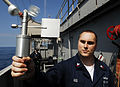 US Navy 090508-N-9928E-032 PACIFIC OCEAN (May 8, 2009) Aerographer's Mate 2nd Class Derron Gee, from East Haven, N.Y., uses a handheld anemometer to determine wind speed.jpg