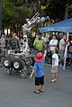 US Navy 090804-N-7915T-098 Children interact with a RONS robot used by Explosive Ordnance Disposal Mobile Unit (EODMU) 8 Detachment Europe during the 26th annual National Night Out.jpg