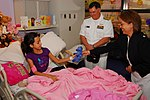 US Navy 091027-N-1854W-012 Rear Adm. Mark Skinner, program executive officer for Tactical Aircraft Programs, center, and Cmdr. Melanie F. O'Brien, commanding officer of Navy Recruiting District Houston, visit a patient.jpg