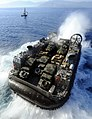 US Navy 100122-N-5345W-003 A landing craft air cushion exits the well deck of USS Bataan (LHD 5).jpg