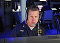 US Navy 100310-N-7058E-054 Lt. Cmdr. Mark West stands the tactical action officer watch in the mission control center aboard the littoral combat ship USS Freedom (LCS 1).jpg