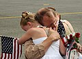 US Navy 100609-N-9860Y-003 Chief Naval Aircrewman Stan Culbertson is greeted by his daughters during a homecoming at Naval Air Station Whidbey Island.jpg