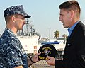 US Navy 101119-N-5812W-001 Cmdr. Robert Chadwick, commanding officer of the guided-missile destroyer USS Roosevelt (DDG 80), welcomes aboard the As.jpg