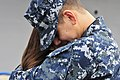 US Navy 110321-N-BT887-113 Culinary Specialist 3rd Class Abel Duran hugs his wife before deploying aboard the amphibious transport dock ship USS Cl.jpg