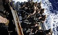 US Navy 110505-N-OS574-464 Marines prepare to hook a rigid-hull inflatable boat during a visit, board, search and seizure, hook and pull exercise.jpg