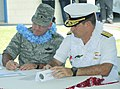 US Navy 110513-N-8185D-010 Brig. Gen. John Doucette and Rear Adm. Paul Bushong sigh a charter with Guam.jpg