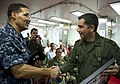 US Navy 110610-N-RM525-293 Commodore Brian Nickerson shakes hands with a Colombian military service member after presenting him with a gift at the.jpg